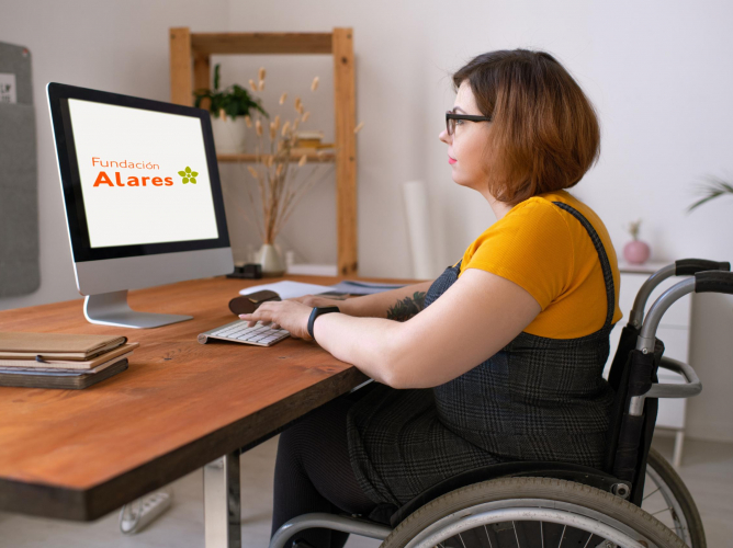 Serious young disabled woman in glasses sitting in wheelchair and entering login while preparing to start e-learning class at home